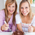 幸せ · 友達 · ケーキ · 笑みを浮かべて · カメラ · 座って - ストックフォト © wavebreak_media
