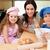 Mother and her children preparing cookies together stock photo © wavebreak_media