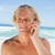 Blonde man talking on his mobile phone while standing on the beach stock photo © wavebreak_media