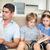 homem · dois · crianças · sessão · sala · de · estar · leitura - foto stock © wavebreak_media