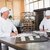 человека · микроволновая · печь · печи · молодым · человеком · кухонном · столе - Сток-фото © wavebreak_media