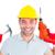 happy repairman holding hammer and drill machine stock photo © wavebreak_media