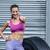smiling muscular woman gesturing thumbs up stock photo © wavebreak_media