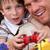 portré · boldog · apa · fia · játszik · videojátékok · otthon - stock fotó © wavebreak_media