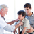 senior doctor examining a little boy with his father stock photo © wavebreak_media