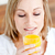 portret · charmant · vrouw · sinaasappelsap · home - stockfoto © wavebreak_media