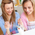 Two friends eating ice in the kitchen stock photo © wavebreak_media