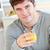 attrattivo · giovane · bere · succo · d'arancia · cucina · sorridere - foto d'archivio © wavebreak_media