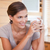 gülen · genç · kadın · fincan · kahve · ev - stok fotoğraf © wavebreak_media