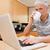 человека · ноутбук · питьевой · кофе · кухне · интернет - Сток-фото © wavebreak_media