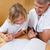 Man explaining homework to his son stock photo © wavebreak_media