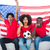 cheering football fans in red sitting on couch with usa flag stock photo © wavebreak_media
