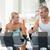 Fit couple working on exercise bikes at gym stock photo © wavebreak_media