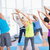 people doing stretching exercise in yoga class stock photo © wavebreak_media