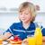 Cute boy eating waffles with strawberries stock photo © wavebreak_media