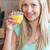 encantador · mulher · potável · suco · de · laranja · sorridente · câmera - foto stock © wavebreak_media