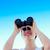 smiling businesswoman looking through binoculars stock photo © wavebreak_media