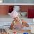 belle · jeune · fille · travail · cuisine · cookies - photo stock © wavebreak_media