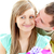 vonzó · fiúbarát · ajándék · csók · mosolyog · barátnő - stock fotó © wavebreak_media