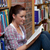 Pretty young woman reading a book sitting on the floor in a bookstore stock photo © wavebreak_media