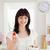 csinos · barna · hajú · női · eszik · koktélparadicsom · tart - stock fotó © wavebreak_media