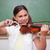 smiling schoolgirl playing the violin in a classroom stock photo © wavebreak_media