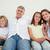 gelukkig · gezin · vergadering · sofa · samen · meisje · glimlach - stockfoto © wavebreak_media