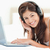 mulher · olhando · para · a · frente · sorridente · laptop · fones · de · ouvido - foto stock © wavebreak_media