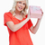 Young woman proudly holding her birthday gift against a white background stock photo © wavebreak_media