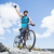 fit man cycling on rocky terrain and cheering stock photo © wavebreak_media