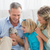 Smiling parents and daughter sitting with rabbit together stock photo © wavebreak_media
