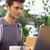 jovem · estudante · usando · laptop · sessão · livros - foto stock © wavebreak_media