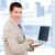 positief · zakenman · met · behulp · van · laptop · permanente · kantoor · internet - stockfoto © wavebreak_media