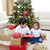 happy children celebrating christmas at home stock photo © wavebreak_media