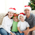 Adorable family at Christmas sitting in the living-room at home stock photo © wavebreak_media