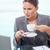 Portrait of a businesswoman drinking coffee in her office stock photo © wavebreak_media