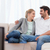 Smiling couple watching TV in their living room stock photo © wavebreak_media
