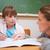 schoolmeisje · schrijven · leraar · praten · klas · vrouw - stockfoto © wavebreak_media