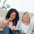 two surprised young women are sitting down reading a magazine stock photo © wavebreak_media