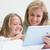 happy mother and daughter using tablet stock photo © wavebreak_media
