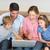 aile · dizüstü · bilgisayar · kullanıyorsanız · birlikte · kanepe · dört · oturma - stok fotoğraf © wavebreak_media