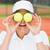 pretty tennis player holding balls over her eyes stock photo © wavebreak_media