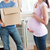 cute pregnant wife looking at her husband holding box standing in their new kitchen during removal stock photo © wavebreak_media