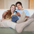 relaxed couple watching television in their living room stock photo © wavebreak_media