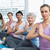 class sitting with joined hands in a row at yoga class stock photo © wavebreak_media