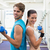 fit couple exercising together with blue dumbbells stock photo © wavebreak_media