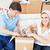 Joyful caucasian couple unpacking boxes with glasses in their new house stock photo © wavebreak_media