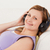 bella · donna · ascoltare · musica · divano · soggiorno · sorriso - foto d'archivio © wavebreak_media