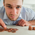 Desperate young businessman counting his change stock photo © wavebreak_media