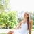 jonge · vrouw · ontspannen · gras · park · glimlach · schoonheid - stockfoto © wavebreak_media